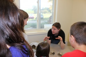 Scientist Leila Desotelle talks with students about stream macro-invertebrates at Kellogg Biological Station.
